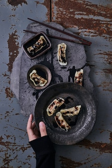 Chinese dumplings with soy dipping sauce.