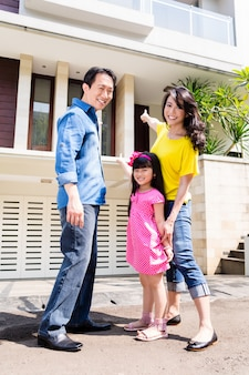 Chinese family in front of house