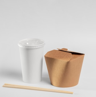 Chinese fast food package with chopsticks and cup