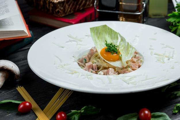 Chinese food, noodles with egg yolk in salad leaf