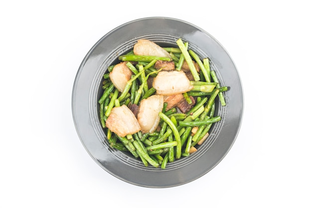 Chinese food:stir fried garlic shoots with pork.