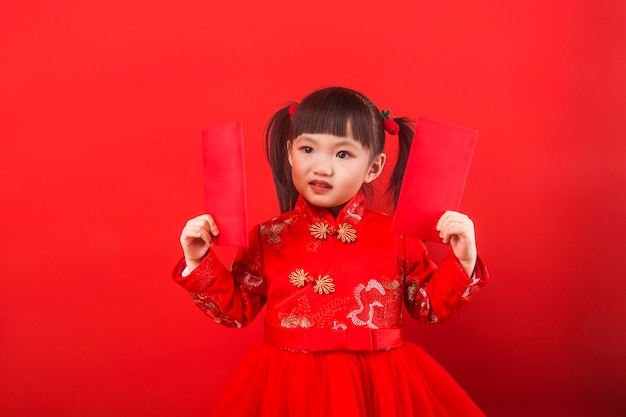A chinese girl celebrates chinese new year with a red envelope
