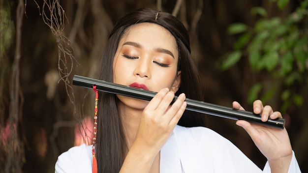 Chinese girl is playing the traditional chinese musical instrument