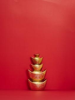Chinese gold ingot on red