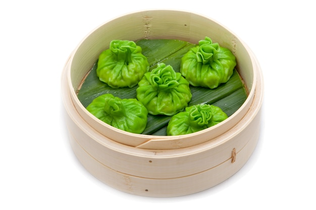 Chinese green steamed buns bamboo basket isolated
