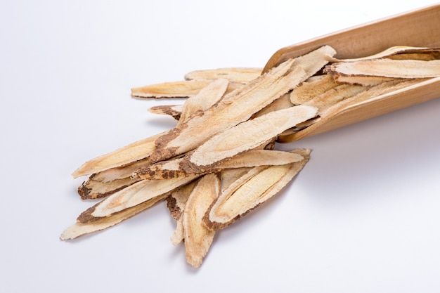 Chinese herbal medicines -- astragalus on white background, blank for text copy space