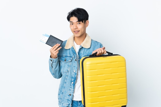 Chinese over isolated space in vacation with suitcase and passport