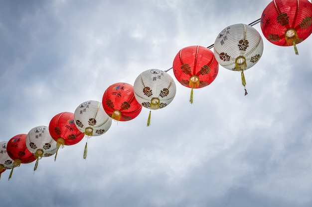 Chinese lanterns adorn in new year (translate text lucky and enriched)