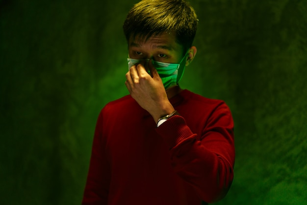 Chinese man covering his mouth and coughing. coronavirus outbreak concept