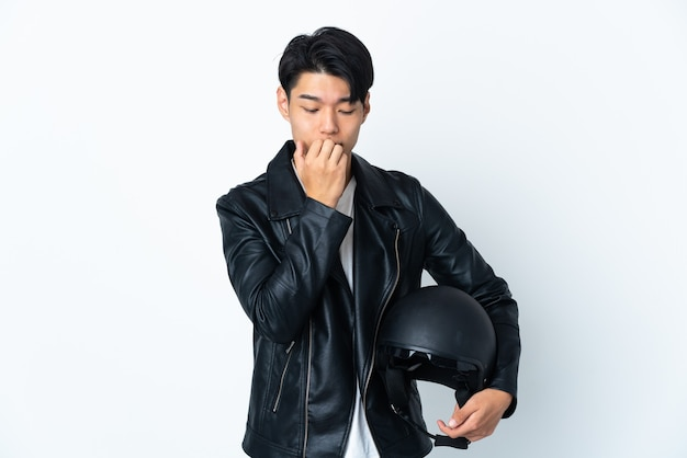 Chinese man with a motorcycle helmet on white having doubts