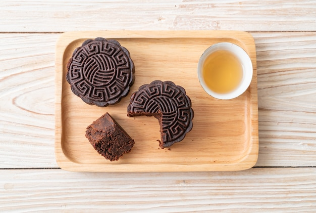 Chinese moon cake dark chocolate flavour on wood plate