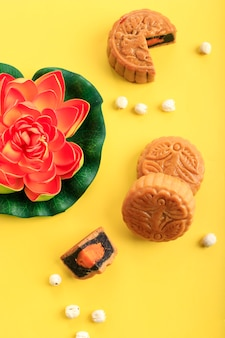 Chinese moon cake (mooncake) chinese dessert snack during lunar new year mid autumn festival on yellow background for advertisement