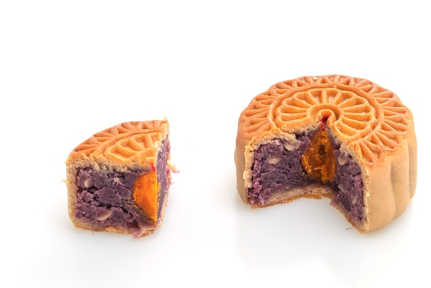 Chinese moon cake purple sweet potato and egg yolk flavour isolated on white background