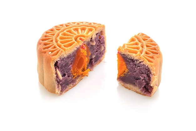Chinese moon cake purple sweet potato and egg yolk flavour isolated on white