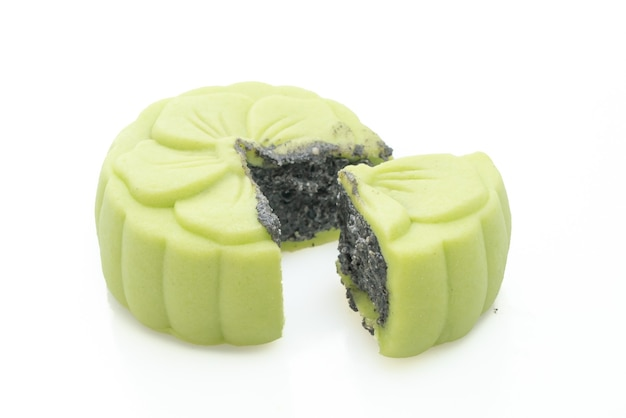 Chinese moon cake with green tea flavour with black sesame isolated on white surface