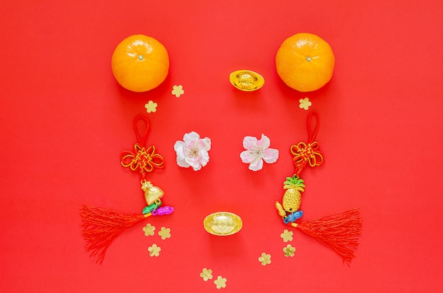 Chinese new year 2020 festival decoration set as rat face on red background. flat lay for lunar year . chinese language on the decoration means fortune