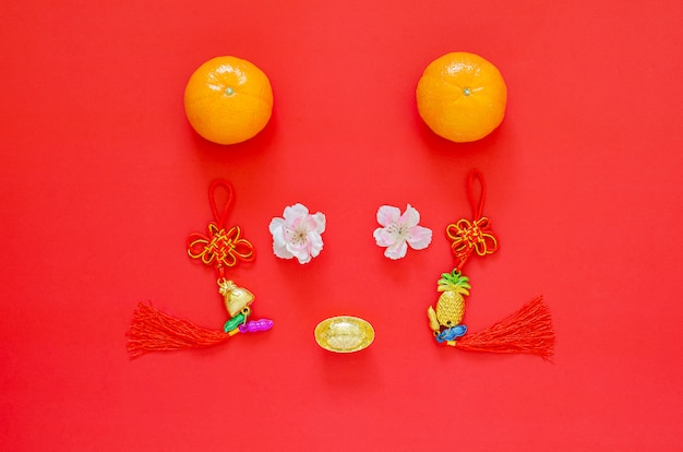 Chinese new year 2020 festival decoration set as rat face on red . flat lay for lunar year . chinese character on the decoration means fortune