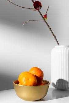 중국 새 해 2021 오렌지와 꽃