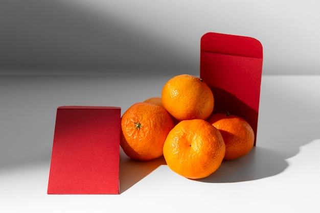 Chinese new year 2021 red envelopes and oranges
