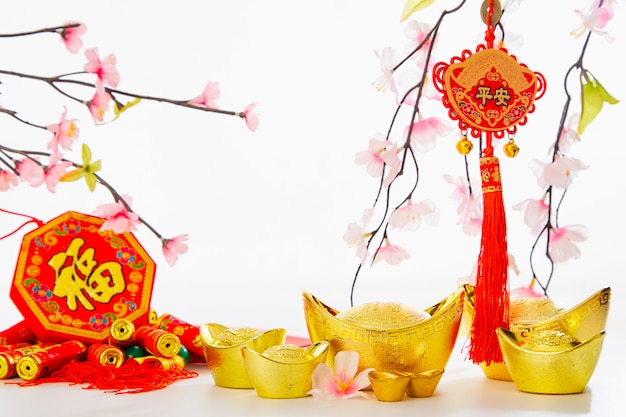 Chinese new year background 2019 traditional gold ingot and plum tree