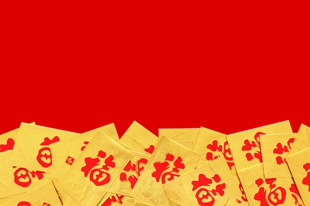Chinese new year  concept. gold envelope (ang pao) on red background, top view