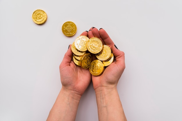 Chinese new year concept with hands holding coins