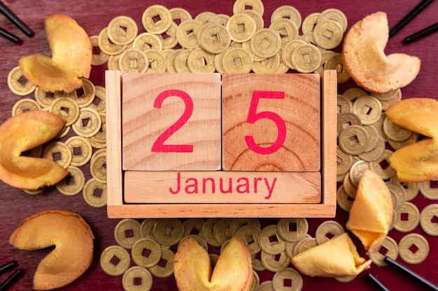 Chinese new year date with fortune cookies and coins