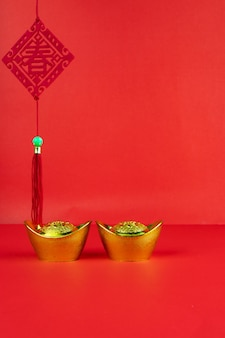 Chinese new year decoration on a red background flag of good fortune and lump of gold