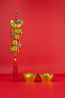 Chinese new year decoration on a red background symbol of good fortune and lump of gold