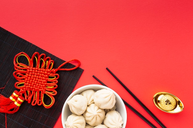 Chinese new year dumplings with chopsticks