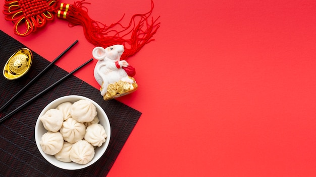 Chinese new year dumplings with rat figurine