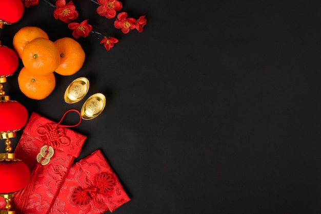 Chinese new year festival concept, flat lay top view, happy chinese new year with red envelope and gold ingot