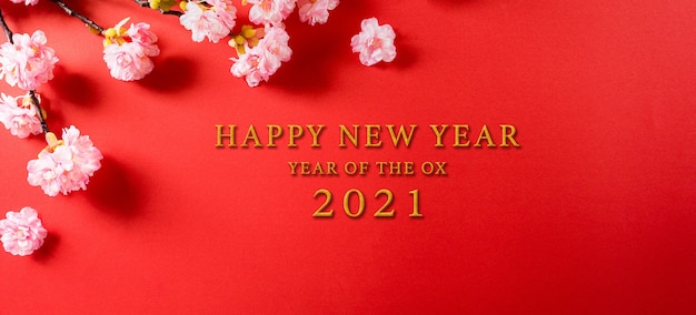 Chinese new year festival decorations made from plum blossom on a red background