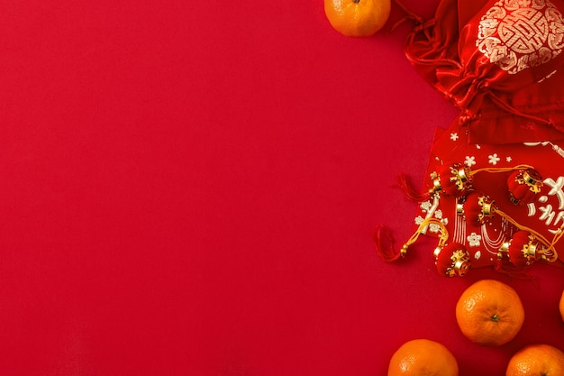 Chinese new year festival decorations and oranges on red background