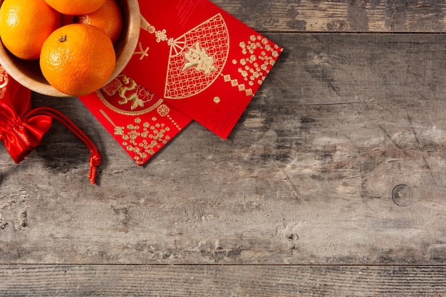 Chinese new year festival decorations and oranges on wooden background