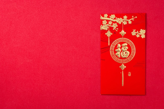 Chinese new year festival envelope on red background.