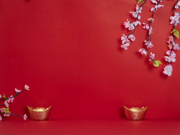 Chinese new year. flowers and chinese gold ingot