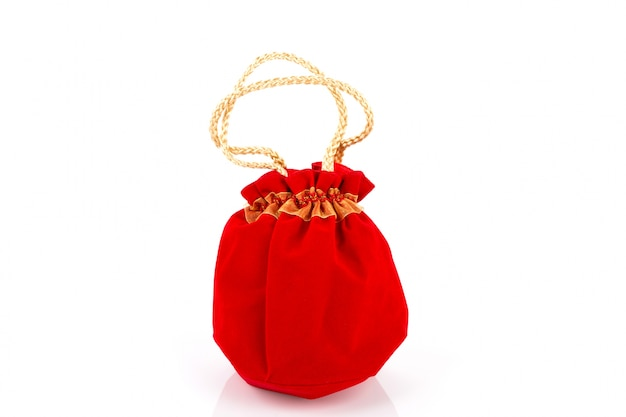 Chinese new year gift bag and decoration on white background