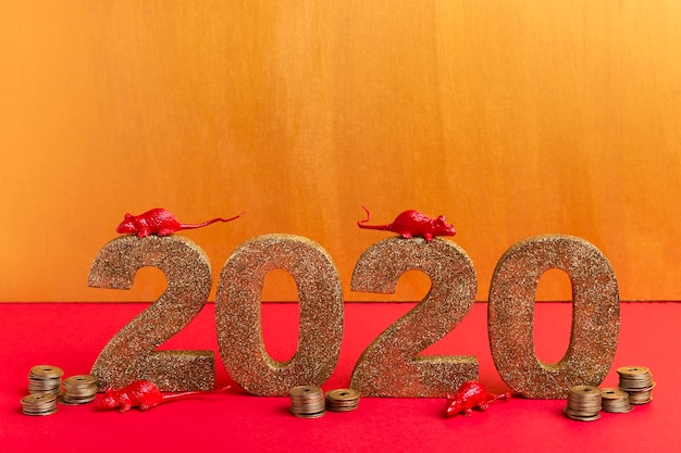 Chinese new year golden number with rat figurines and coins