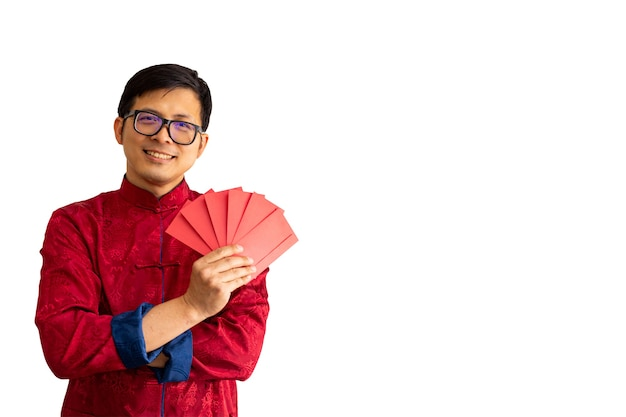 Chinese new year man holding red envelope and smiling for celebration.