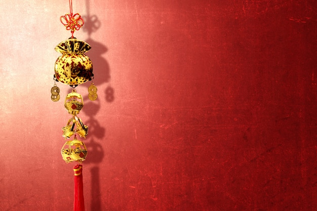 Chinese new year ornament over red wall