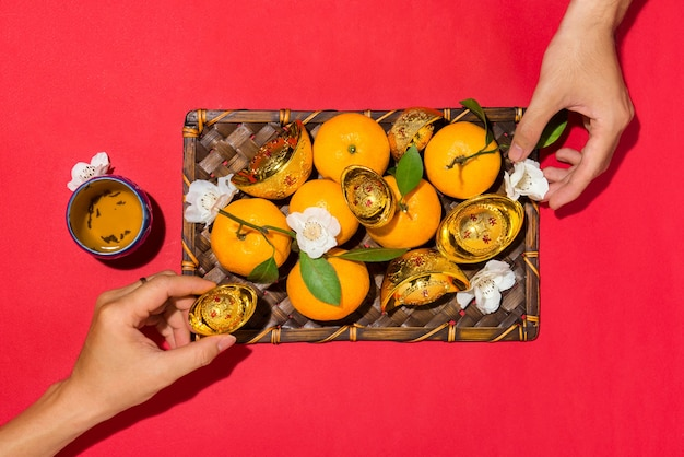 Chinese new year's decoration. mandarin orange and gold sycee.