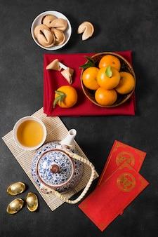 Китайский новый год с чайником и мандаринами