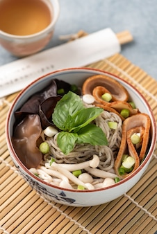 Chinese noodle with mushroom vegetables and chopstick