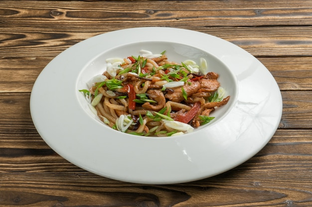 Chinese noodles with chicken fried bell pepper and onion in teriyaki sauce.