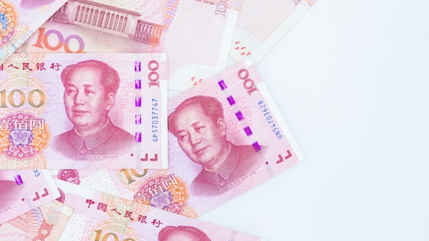 Chinese paper currency yuan renminbi bill banknotes on white background, banknote one hundred yuan, more chinese yuan background, china or economy of asia growth, us trade war concept.