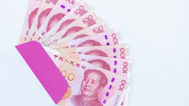 Chinese paper currency yuan renminbi bill banknotes on white background