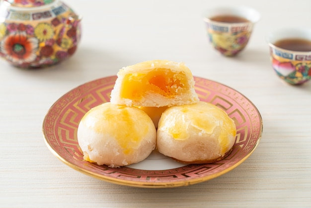 Chinese pastry moon cake with salted egg peanut or spring roll pastry with nuts and salted eggs - asian food style