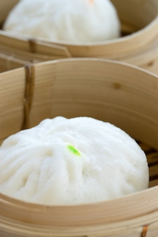 Chinese pork meat bun in wooden container