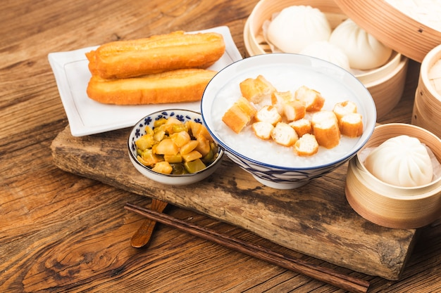 Chinese porridge breakfast set, fried dough sticks, white porridge,